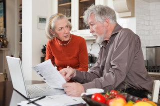 Image: Senior couple discussing their bills