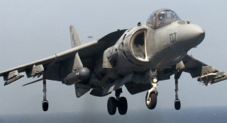 Image: A United States Marine Corps AV-8B Harrier jet makes a vertical landing on the deck of the British strike carrier HMS Illlustrious