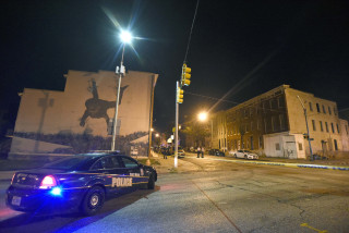 Baltimore police work the scene of the Saturday night shooting.