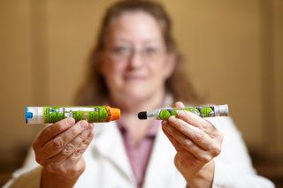Image: Dr. Julie C. Brown of University of Washington Medicine pediatrics/emergency medicine holding EpiPens, the new design (left) and old EpiPen (right), Monday, Sept. 19, 2016, Seattle, Washington.