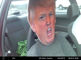 Image: A trooper stopped a vehicle in the carpool lane driving with a cutout of Donald Trump in the passenger's seat