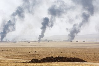 Image: Smoke rises from clashes with Islamic State militants on the southeast of Mosul