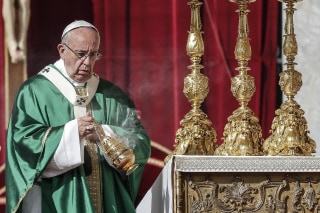 Image: Pope Francis arrives to celebrate mass in St. Peter's Square at the Vatican on Sunday