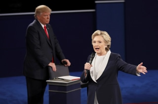 Image: While Hillary Clinton spoke, Donald Trump grabbed the back of his seat