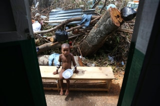 Image: A child sick with cholera receives medical assistance at Saint Antoine hospital in Jeremie, Haiti, Monday.