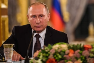 Image: TRussia's Vladimir Putin takes part in a news conference Monday.