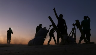 Image: Syria rebel fighters cheer as they fight ISIS jihadists on the outskirts of the northern Syrian town of Dabiq.