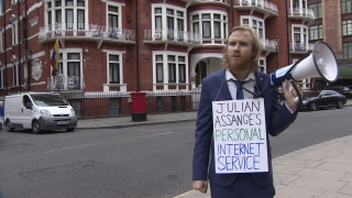 Image: A comedian reads the Internet to Julian Assange outside Ecuador's embassy in London