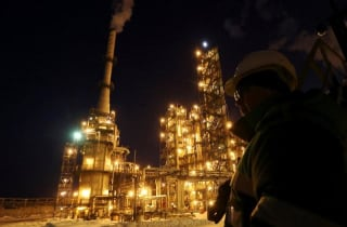 A worker looks on at the Bashneft-Ufaneftekhim oil refinery outside Ufa