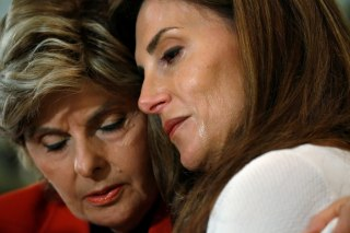 Image: Lawyer Gloria Allred hugs crying Karena Virginia