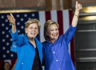 Image: Former Secretary of State Hillary Clinton accompanied by Senator Elizabeth Warren