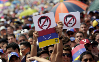 Image: Opposition supporters take part in a rally against Venezuela's President Nicolas Maduro's government in Caracas