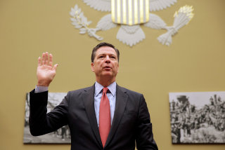 """Image: FBI Director Comey is sworn in before testifying before a House Judiciary Committee hearing on """"Oversight of the Federal Bureau of Investigation"""" on Capitol Hill in Washington"""