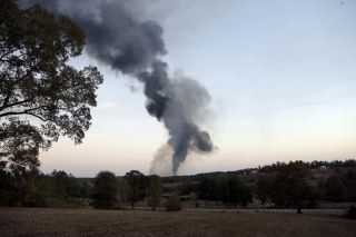 Image: Smoke rises into the sky from a gas line explosion in western Shelby County
