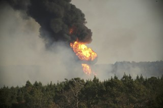 Image: Flames shoot into the sky from a gas line explosion in western Shelby County