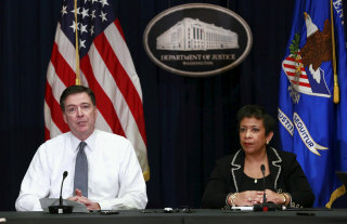 Lynch and Comey hold a media briefing at the Justice Department