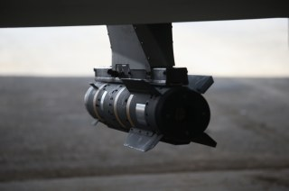 Image: A Hellfire missile hangs from a U.S. Air Force MQ-1B Predator