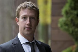 Facebook CEO Mark Zuckerberg looks on before a meeting with Russian Prime Minister Medvedev at Gorki residence outside Moscow