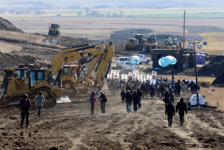 Image: Protesters march along the pipeline route during a protest against the Dakota Access pipeline near the Standing Rock Indian Reservation in St. Anthony, North Dakota