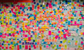Image: A wall is covered with post-it notes as part of the art piece 'Subway Therapy' on the Union Square