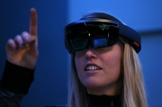 Image: A Microsoft employee demonstrates the Microsoft HoloLens augmented reality (AR) viewer