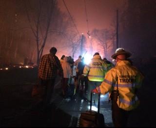 Image: Troopers evacuate residents in Gatlinburg, Tennessee