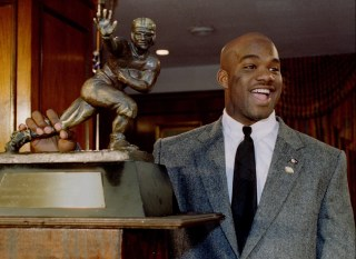 Image: Colorado tailback Rashaan Salaam with the Heisman Trophy in New York