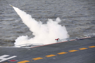 Image: A missile being fired from the Liaoning aircraft carrier during military drills in the Bohai Sea