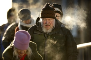 Image: Commuters in Portland, Maine, Friday where the temperature hit low of minus-2 degrees F with a wind chill of minus-25.