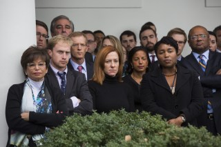 Image: White House staff members listen to President Barack Obama speak about Donald Trump's victory in the Rose Garden of the White House