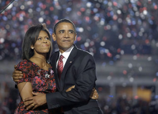 Image: Democratic presidential candidate, Sen. Barack Obama, D-Ill., hugs his wife, Michelle Obama, after giving his acceptance speech at the Democratic National Convention at Invesco Field at Mile High in Denver, Aug. 28, 2008.