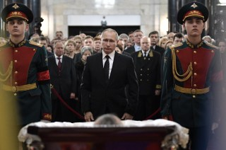 Image: Putin attends the funeral ceremony for Andrei Karlov.