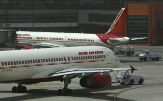 Image: Air India planes are parked on the tarmac at the Terminal 3 of Indira Gandhi International Airport in New Delhi, India.