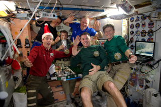 Image: All six members of the Expedition 50 crew aboard the International Space Station celebrated the holidays together with a festive meal