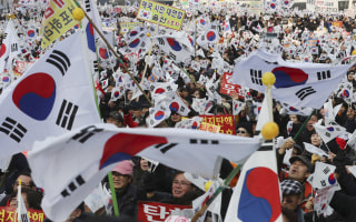 Image: Amid rallies demanding the president's removal, her supporters waved national flags.