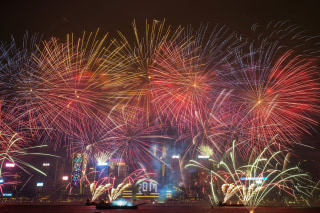 Image: Fireworks illuminate the city's skyline during New Year countdown celebrations
