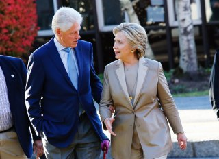 Image: Then Democratic presidential nominee Hillary Clinton talks with her husband, and former President, Bill Clinton