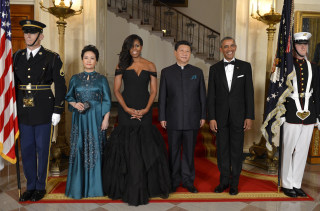 Image: President Barack Obama and first lady Michelle Obama pose with Chinese President Xi Jinping and Madame Peng Liyuan as they arrive for a State Dinner at the White House, in Washington, D.C, on Sept.25, 2015.