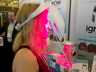 Image: NBC News technology reporter Alyssa Newcomb tries on the iDerma from Apira Science.