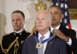 Image: President Barack Obama (R) presents the Medal of Freedom to Vice-President Joe Biden during an event  in the State Dinning room of the White House, on Jan. 12, 2017 in Washington, D.C.