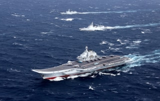 Image: China's Liaoning aircraft carrier with accompanying fleet conducts a drill in the South China Sea