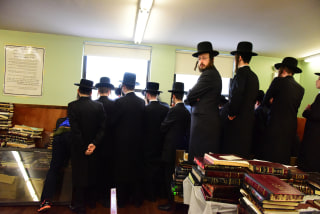 Students watch funeral from second floor of yeshiva.