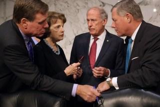 Image: Senate Committee on Intelligence members Sen. Mark Warner, Sen. Dianne Feinstein, Sen. Dan Coats, and Chairman Richard Burr confer before hearing a testimony on Capitol Hill on Sept. 27, 2016 in Washington, D.C.