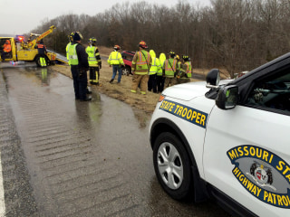 Image: Missouri State Highway Patrol assist a vehicle that has slid off the highway due to icy conditions, Jan. 14, 2017.