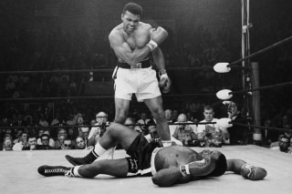 Image: Heavyweight champion Muhammad Ali stands over fallen challenger Sonny Liston, shouting and gesturing shortly after dropping Liston with a short hard right to the jaw on May 25, 1965, in Lewiston, Maine.