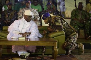 Image: A Gambian officer speaks to President Yahya Jammeh during his final rally in Banjul, Gambia on Nov. 29, 2016.