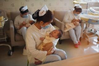 Image: Nurses holding babies