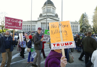 Image: People participate in an anti-abortion rally in Olympia, Wash.