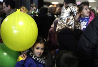 Image: Sima plays with a balloon