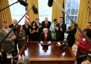 Image: Trump signs an executive order cutting regulations